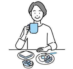 パンの朝食を食べるシニア女性
